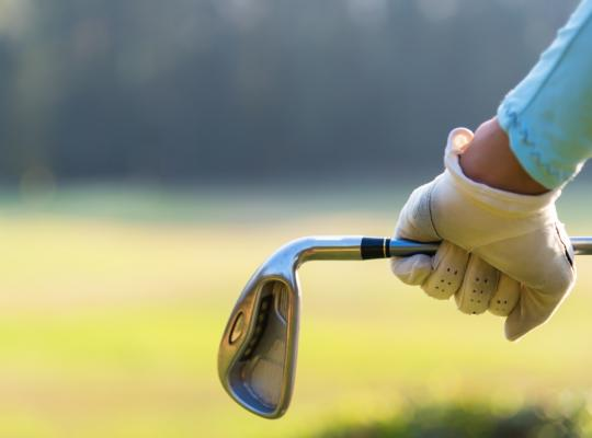 golfer holding golf club