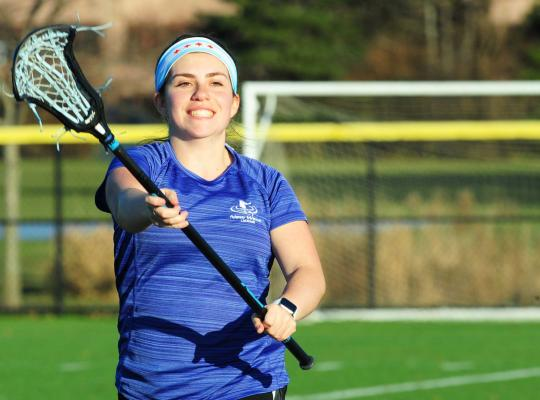 Patient Kalie Miller playing lacrosse