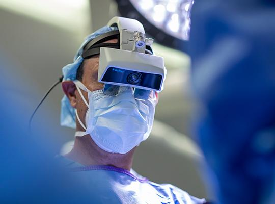dr. frank phillips wearing augmedics xvision headset